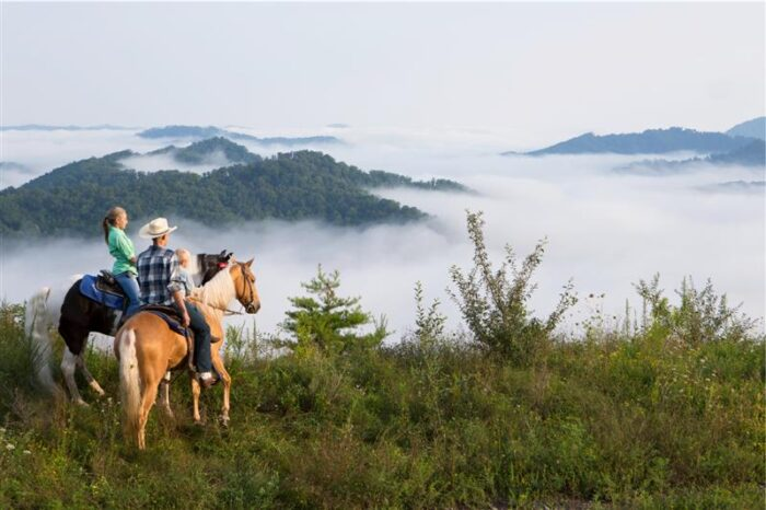 Kentucky horseback riders near Appalachian mountains