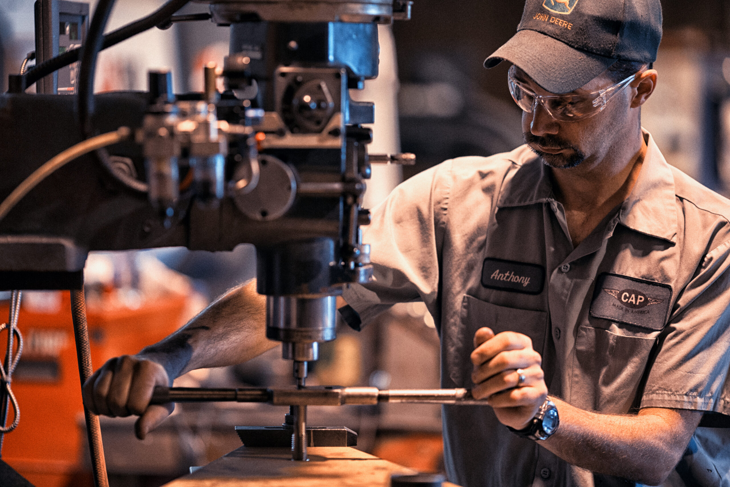 Man works on machinery in manufacturing setting