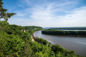 Mississippi River surrounded by railroad track and trees